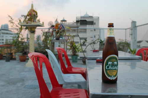 Big Bottle of Chang Beer for Mike: $1.62. He Quite Enjoyed Drinking a Beer on the Roof Before Sunset.