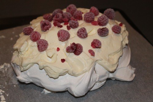 Pavlova: Meringue Topped with Cream and Berries.
